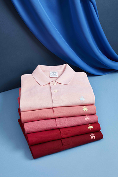 Polo shirts in the shade of red all neatly folded