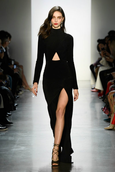 A black cut-out gown