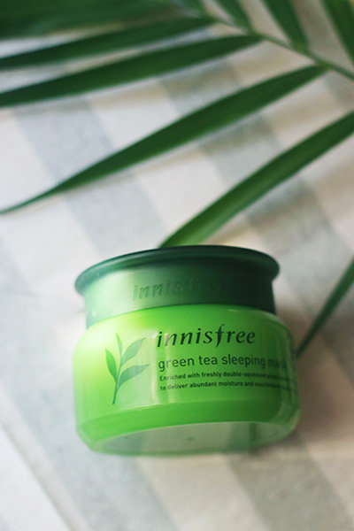 A styled shot of the Innisfree Green Tea Sleeping Mask