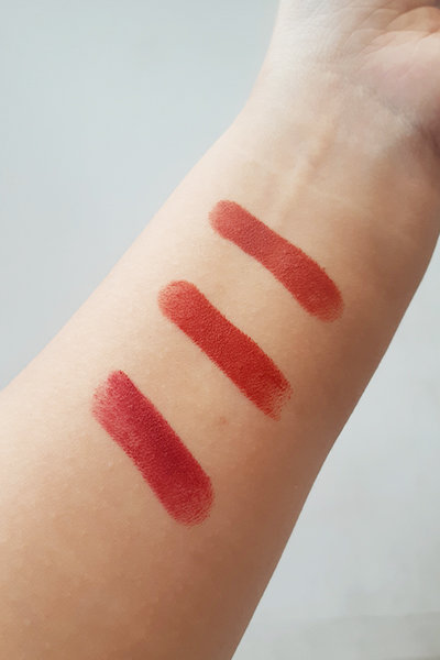 A close-up of Innisfree Vivid Cotton Sticks swatches on reviewer's arm
