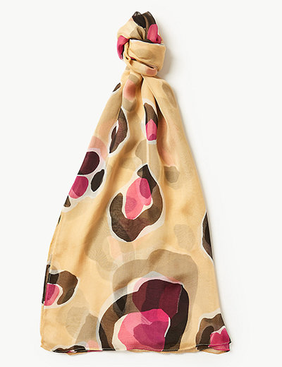 A beige silk animal print scarf