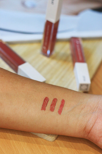 Swatches of three Ofra Liquid Lipsticks.