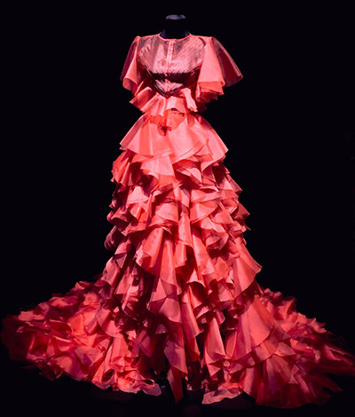 A red gown with a ruffled skirt and train
