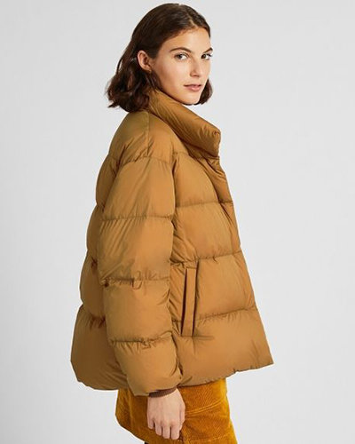 Travel outerwears should be lightweight like this beige Uniqlo Ultra Light Down Cocoon Jacket