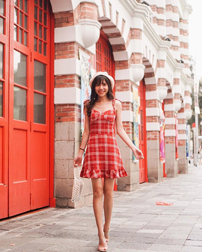 Woman wearing a red plaid dress