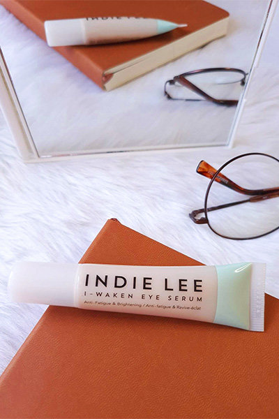 A lifestyle photo of the Indie Lee I-Waken Eye Serum
