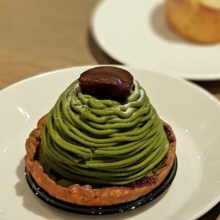 Image of a dessert crowned with matcha