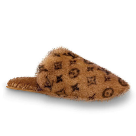 A flat mule crafted from luxurious brown mink fur printed with Louis Vuitton's iconic Monogram pattern.