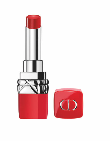 An uncovered red lipstick with red casing