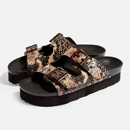 A pair of platform buckled faux snakeskin platform sandals.