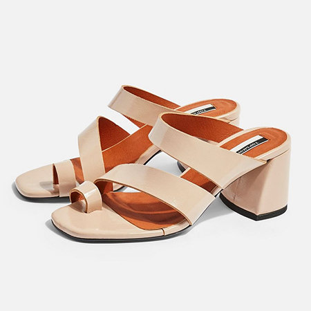 Nude high block heels with cross over straps and toe loops.