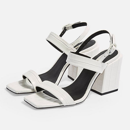 White faux crocodile block heels with buckled straps.