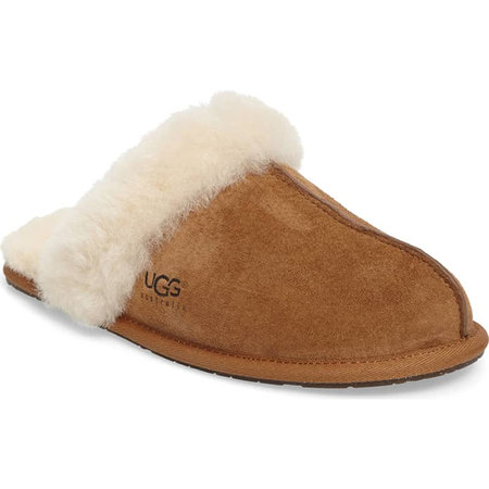 A brown water-resistant suede slipper is trimmed with  white shearling.