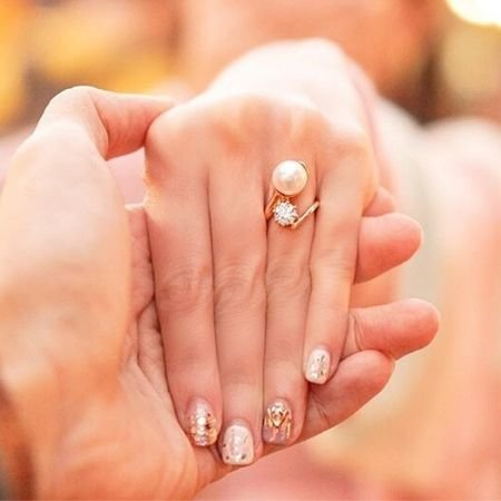 Manicured engagement nails with engagement ring