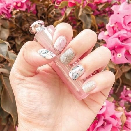Winnie Lee's vacations nails were blush pink and silver glitters