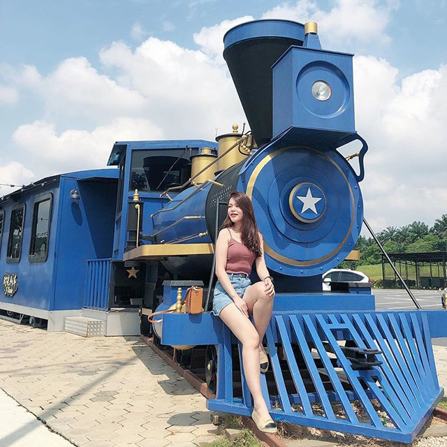 Woman sitting on a train wearing short shorts