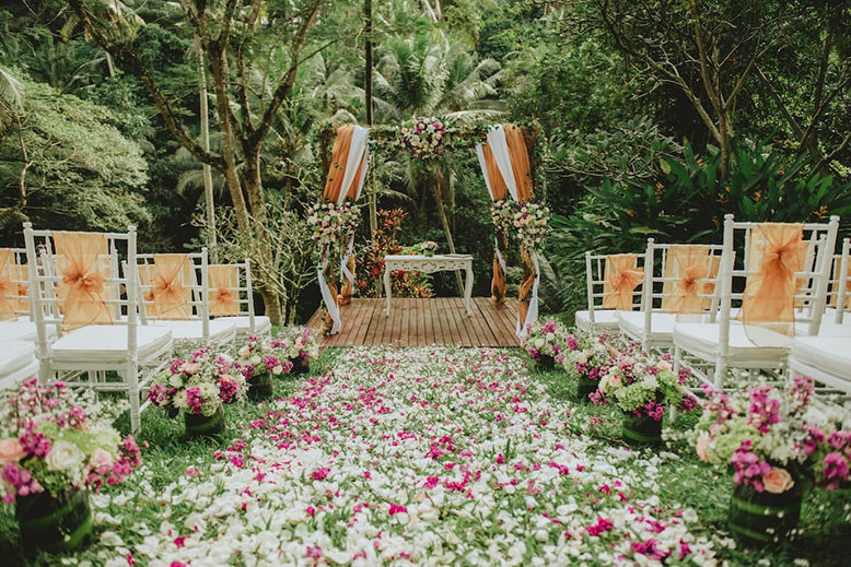 A lush secluded area near the jungle dressed as a wedding venue