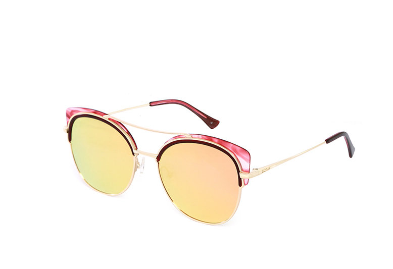 Sunglasses with a pair of yellow lenses and pink marble-like acetate frame that accentuates the eyes.