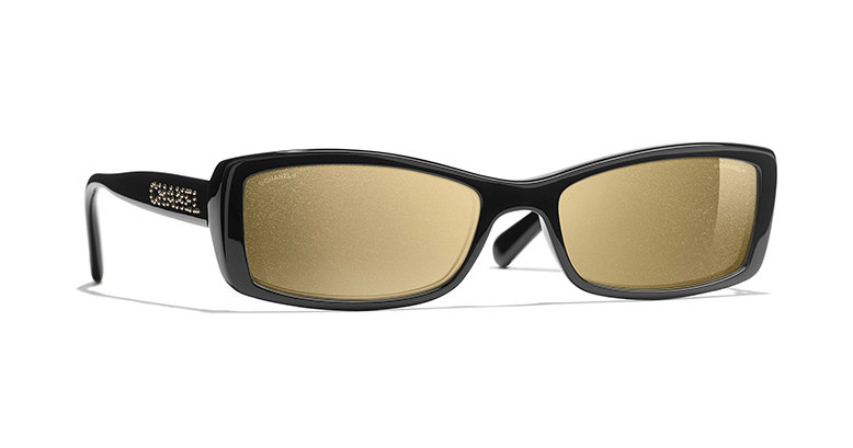 A pair of black rectangular-framed sunglasses with a pair of glittery 18-karat gold lenses.