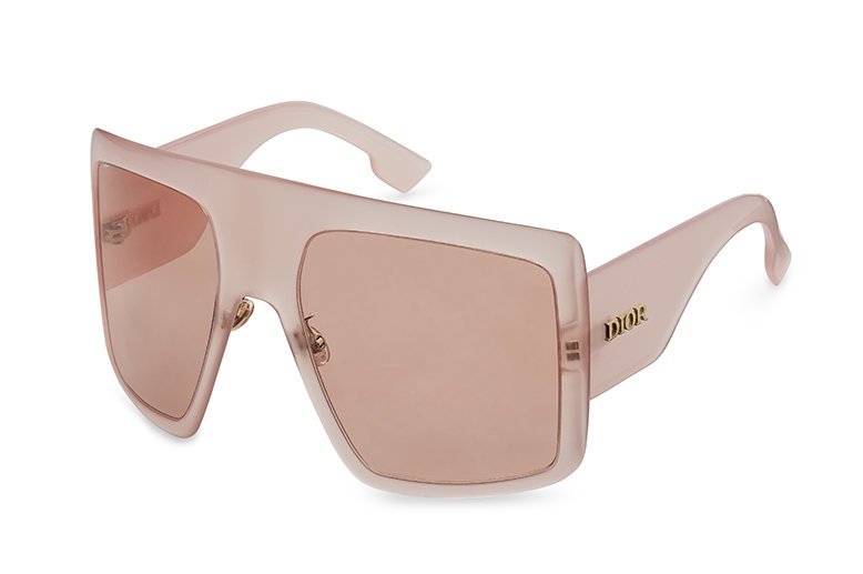 Statement oversized mask-like sunglasses with translucent pink ultra-thin and curved square frame similarly toned with the lenses.
