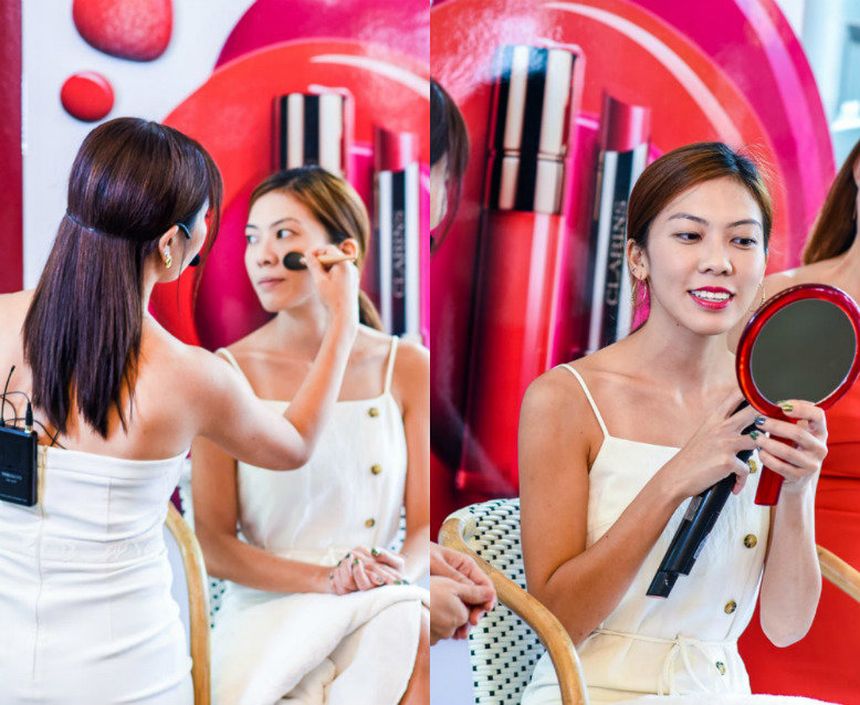 Woman doing another woman's makeup using Clarins' new makeup launches