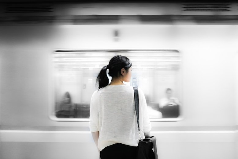 Woman in front of a moving train