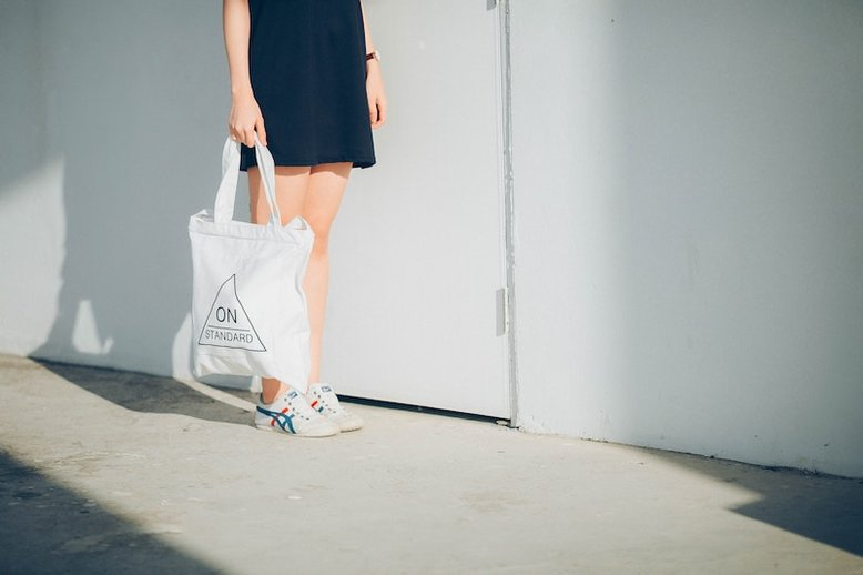 Woman carrying a canvas bag