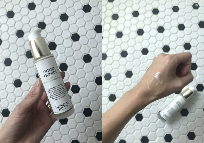 A bottle of skincare product, and a hand with white cream spread on it