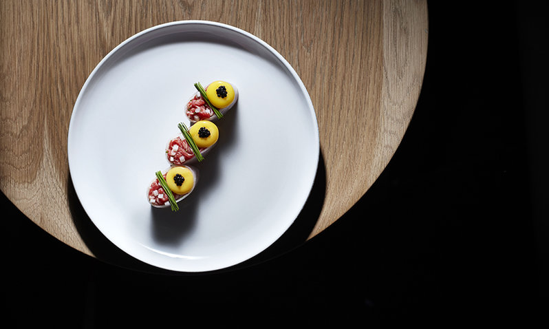 striploin served with nashi pear and sesame soy, topped with a quail egg yolk and seaweed caviar.