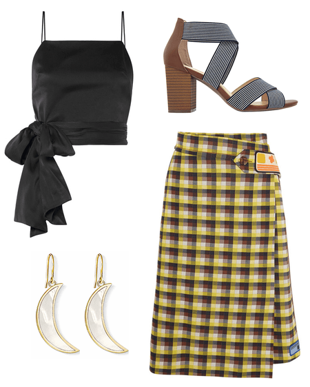 A black cropped silk-blend top with a huge ribbon, a yellow checked jacquard-knit wrap skirt, a pair of crescent moon dangling earrings, and a high-heeled sandal with a blue and white striped straps