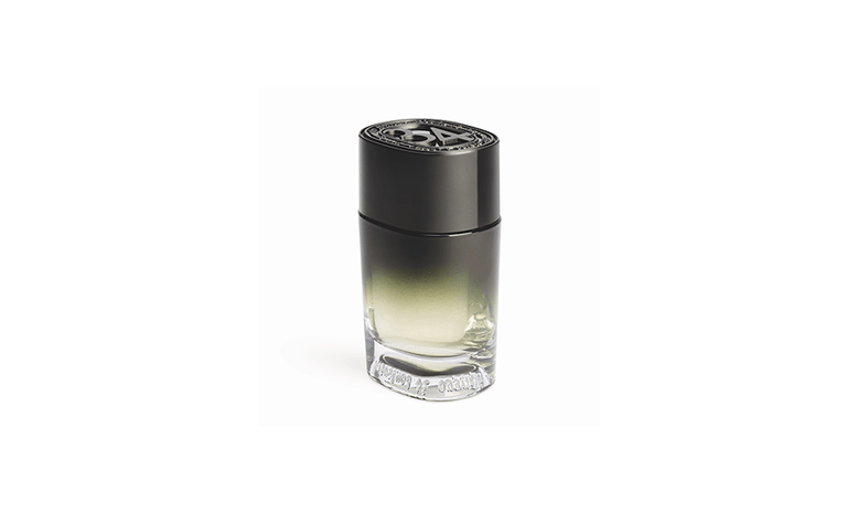 A small bottle of perfume with black cap