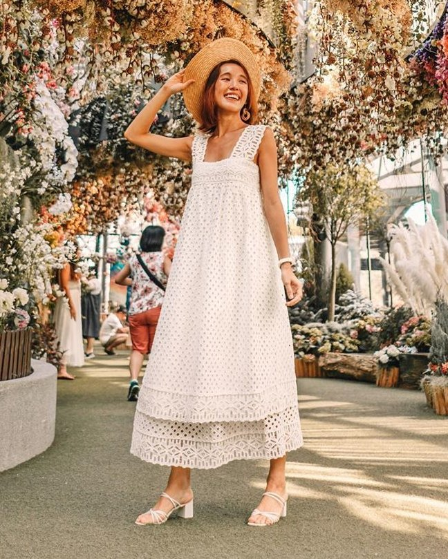 A girl wearing a white lace tent dress.