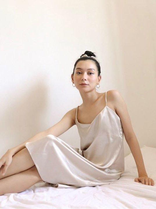 Girl in silk sleepwear dress