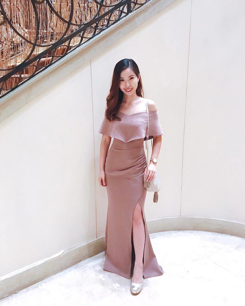 Woman wearing an off-shoulder slit gown